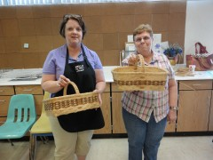 Michelle and Linda proudly display their baskets