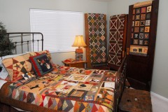 Alphabet Quilt (on the bed) Pattern by Cheri Payne (L to R) Churn Dash, Chimneys and Cornerstones, Easy as ABC