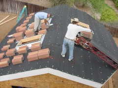 Time to install roof tile