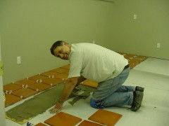 The walls were painted, now Jerry is installing the saltillo tile floor